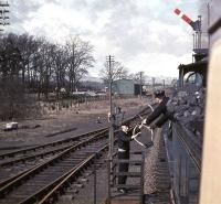 The fireman of Caledonian 123 collects the tablet from the Doune signalman on 12 April 1963. The train is Scottish Rambler No 2 on its way from Glasgow Central to Killin Junction.<br><br>[John Robin&nbsp;12/04/1963]