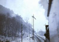 CR 123 about to run into a snowstorm near Craig-na-Cailleach platform on the shores of Loch Lubnaig between Callander and Strathyre. The date is 12 April 1963 and the train is the SLS/BLS <I>Scottish Rambler No 2</I> on its way to Killin Junction. Note the trip wire signals. <br><br>[John Robin&nbsp;12/04/1963]