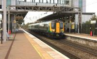 A London Midland Class 350 emu departs from Liverpool South Parkway on 4 November 2014 with the 1534 Liverpool Lime Street - Birmingham New Street. The modern 6 platform station in the Garston district of Liverpool opened in 2006.<br><br>[John McIntyre&nbsp;04/11/2014]