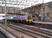 The 1400 Manchester Airport - Edinburgh Waverley TransPennine Express service calls at Carlisle on 20 May 2014.<br><br>[Ken Strachan&nbsp;20/05/2014]