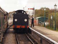 The signalman at Harmans Cross station on the Swanage Railway exchanges the single line tokens with the crew of a Swanage bound train on 19 October 2014.<br><br>[John McIntyre&nbsp;19/10/2014]