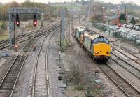 Two Class 37s take the Down Fast through Lancaster station on 6 November, avoiding the platform road. DRS 37610 and 37602 are on the morning Crewe - Sellafield nuclear flasks service.<br><br>[Mark Bartlett&nbsp;06/11/2014]