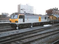 Standing at the south end of Crewe station on 9 January 2014 is DB 92036 <I>Bertolt Brecht</I> with a short rake of refurbished rolling stock destined for Bescot yard following repair at Crewe EMD. <br><br>[David Pesterfield&nbsp;09/01/2014]