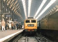 One of the Finsbury Park batch of Brush Type 4s, no 1775, stands alongside a classmate at the buffer stops at Kings Cross station in June 1969 after bringing in ecs from Holloway carriage sidings.<br><br>[John Furnevel&nbsp;06/06/1969]