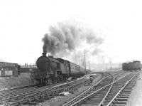 Parkhead V3 2-6-2T no 67676 tops the 1:88 grade westbound at Kelvinhaugh Junction on 14 July 1961 with a Bridgeton Central - Helensburgh Central train.<br><br>[G H Robin collection by courtesy of the Mitchell Library, Glasgow&nbsp;14/07/1961]