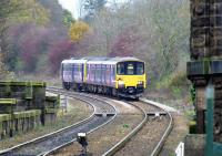 The 14.15 for York approaches Knaresborough on 13 November 2014, complete with moustache for 'Movember'. The last two vehicles are Class 142 Pacers, or 'nodding donkeys'. Being in one of these was akin to riding in a mineral wagon at Waterside.<br><br>[Colin Miller&nbsp;13/11/2014]