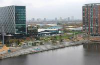 The Metrolink tram terminus at Media City UK, as seen from the Air Shard viewing platform at the Imperial War Museum on 16 November. A tram is arriving off the Eccles line, the triangular junction with which is just behind the large building on the right of this picture. <br><br>[Mark Bartlett&nbsp;16/11/2014]