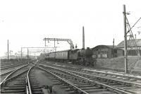V3 67679 eastbound under the wires at Kelvinhaugh Junction on 14 July 1961. The train is about to start the descent to Finnieston [NBR] on a Dalmuir Park to Bridgeton Central service. This was the period during which steam hauled services had been hastily reinstated following temporary withdrawal of the Class 303 (originally AM3) electric units to remedy a fault with the switchgear. [See image 49348] <br><br>[G H Robin collection by courtesy of the Mitchell Library, Glasgow&nbsp;14/07/1961]