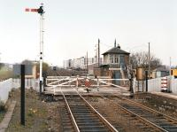 Looking west over the level crossing from Kingsknowe Station around 1980 with the brake van of a freight train disappearing into the distance.  Engineers wagons occupy the sidings on the right.<br><br>[Bill Roberton&nbsp;//1980]