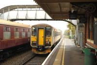 Platform scene at Chappel and Wakes Colne on 16 November showing Greater Anglia unit 153322 calling with the 10.26 Sudbury - Marks Tey service. <br><br>[Peter Todd&nbsp;16/11/2014]