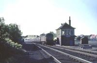 Brush Type 4 D1851 runs south through Carluke on 16 July 1965 with a train for Manchester Victoria.   <br><br>[John Robin&nbsp;16/07/1965]