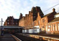 The empty Station Hotel basks in the early morning sunlight overlooking Ayr station on 10 November 2014. Unfortunately this shows up the sad state of the building. At least the pigeons don't seem to have found a way in yet.<br><br>[Colin Miller&nbsp;10/11/2014]
