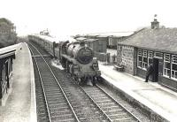 BR Standard class 4 2-6-0 76108 brings a down passenger train into Arnage station on 15 May 1959. <br><br>[G H Robin collection by courtesy of the Mitchell Library, Glasgow&nbsp;15/05/1959]