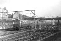 A North Clyde electric multiple unit passing Bellgrove Junction westbound on 15 November 1960 with an Airdrie to Dalmuir Park service.  <br><br>[G H Robin collection by courtesy of the Mitchell Library, Glasgow&nbsp;15/11/1960]