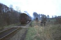 The last vestiges of early morning mist hang around Thorntonhall Lane crossing in April 1966 as an East Kilbride - Glasgow train approaches. This was the final week of steam hauled services on the line.<br><br>[John Robin&nbsp;/04/1966]