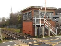 The disused signal box, on the south side of the line, located beyond the Station Road level crossing at the east end of Dodworth Station as seen in November 2014. It replaced the original MS&LR box, which was demolished as a result of a derailment in January 1955.<br><br>[David Pesterfield&nbsp;19/11/2014]