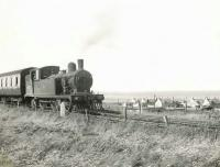 F4 2-4-2T no 67157 approaching St Combs station in the summer of 1954 with the branch train from Fraserburgh. 67157 was the last of the operational Stratford built ex-GER F4s, withdrawn from Kittybrewster shed in June 1956. <br><br>[G H Robin collection by courtesy of the Mitchell Library, Glasgow&nbsp;03/08/1954]