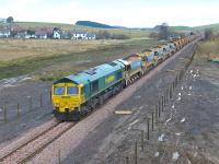 A Borders Railway ballast train photographed on 25 November looking north towards Heriot village. Freightliner locomotives 66605 and 66610 (nearest) are involved.<br><br>[Bill Roberton&nbsp;25/11/2014]