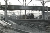 Looking back along the platforms towards the station concourse at Helensburgh Central on 22 October 1960. V1 2-6-2T 67629 is preparing to leave with a train for Bridgeton Central. In the right background other steam locomotives are receiving attention on Helensburgh shed. <br><br>[G H Robin collection by courtesy of the Mitchell Library, Glasgow&nbsp;22/10/1960]
