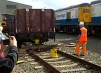 The process to get derailed wagons back on the road usually takes place far from public scrutiny; but this was an Open Day at Etches Park in September 2014. In case you missed it, they use a bottle jack as shown to lift the wagon up; then a hydraulic ram to move it sideways. Notice the Peak on the left, and the class 20's on the right.<br><br>[Ken Strachan&nbsp;13/09/2014]