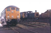 A mix of classic railway vehicles at Steamport, Southport, during an open day in 1982. BR Sulzer 24081, preserved for only two years at this time, was on static display, while 03189, still in BR service at Birkenhead, was shuttling passengers between Steamport and the main line station in a Derby Class 108 DMU. The yellow industrial shunter to the right was still in use in Southport's Coal Concentration Depot.   <br><br>[Mark Bartlett&nbsp;11/09/1982]