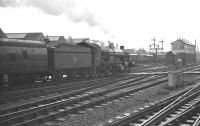 Castle class 4-6-0 no 7035 <I>Ogmore Castle</I> at Swindon station on 30 October 1962 with the 11.45 London Paddington - Cheltenham St James.<br><br>[K A Gray&nbsp;30/10/1962]