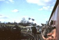 A busy scene at the north end of Dumfries on 15 April 1963. Photograph taken from a window of <I>Scottish Rambler No 2</I> which is waiting to enter the station off the Lockerbie branch behind Jubilee 45588 <I>Kashmir</I>. The hold up is to allow the passage of a London relief, approaching the station in the background behind another Jubilee 45659 <I>Drake</I>. Standing alongside the special is 78026, the Dumfries station pilot.<br><br>[John Robin&nbsp;15/04/1963]