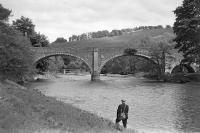 Old photograph looking north east at Ettrickfoot featuring the bridge which used to carry the A7 over the River Tweed just upstream of its confluence with the Ettrick Water. The bridge carrying the Selkirk branch over the combined waters of the Tweed and Ettrick can be seen through the left-hand arch. [Ref query 9279]<br><br>[Bill Jamieson Collection&nbsp;//]