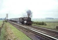 Carstairs based Black 5 no 45173 on Strawfrank Troughs with a Lockerbie train on 24 July 1964. The train has just cleared Float Viaduct which can be seen in the left background. 45173 was withdrawn from 64D later that same month. <br><br>[John Robin&nbsp;24/07/1964]