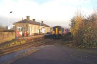150270 arrives at Littleborough with a westbound service to Manchester Victoria on 29 November 2014. The main station building on the eastbound platform is now a local history centre.<br><br>[John McIntyre&nbsp;29/11/2014]