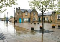 Looking across the station forecourt at Hexham on a grey, wet day in May 2006. Still an attractive station nonetheless.<br><br>[John Furnevel&nbsp;07/05/2006]