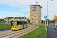 The brand new tram line to Manchester Airport opened in November 2014, over a  year early. The line involves a mixture of reserved and street running sections. One month after opening, Metrolink 3063 swings round the 15mph curve just to the north of Benchill tram stop heading for Manchester. <br><br>[Mark Bartlett&nbsp;02/12/2014]