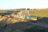 An empty ballast train consisting of 30 vehicles trundles back to base over Falahill at around 2.30pm on 2 December 2014. Freightliner 66605 was on the north end of the train with 66603 bringing up the rear.<br><br>[Bruce McCartney&nbsp;02/12/2014]