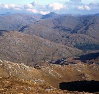 View from near the summit of Beinn Odhar Mhor, on the west side of Loch Shiel on 14 October 2014. The prominent hill in the background is the Munro Sgurr nan Coireachan with the Corbett Sgurr an Utha in front of it. The exhaust trail just visible lower centre is from Black 5 45407 heading for Mallaig with <I>The Jacobite</i>.<br><br>[Bill Jamieson&nbsp;14/10/2014]