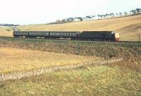 A diverted service off the Edinburgh - Carstairs route heading south at Falahill in 1968 behind an unidentified EE Type 4 locomotive. [See image 49631]<br><br>[Bruce McCartney&nbsp;//1968]