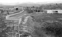 Looking north-west from Duchlage Road over the site of Crieff station to King Street in March 1970. The bridge indicates where the line continued west to Comrie. [See image 27574]<br><br>[Bill Jamieson&nbsp;17/03/1970]