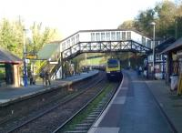 Arrival of the 11.47 to Penzance at Bodmin Parkway on 29 November 2014 - a large train for a small station; which, commendably, has an hourly bus to Padstow, some 50 years after the latter station closed. The lie of the land, and the use of the up platform for Bodmin and Wenford trains, reminds me of Norchard in the Forest of Dean [see image 31050]. The signal box just visible on the right is now used as a cafe.<br><br>[Ken Strachan&nbsp;29/11/2014]