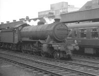Gresley class O2 2-8-0 no 63973 with an up goods through Doncaster on 29 July 1961 passes the restaurant car of a Leeds - Kings Cross train standing at the platform.<br><br>[K A Gray&nbsp;29/07/1961]