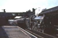 Jubilee 45588 <I>Kashmir</I> recently arrived at Lockerbie from Carlisle on 15 April 1963 with <I>Scottish Rambler No 2</I>. From here the special would head west over the single line Dumfries, Lochmaben and Lockerbie route to reach Dumfries [see image 25465].<br><br>[John Robin&nbsp;15/04/1963]
