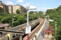 A Springburn train leaving Alexandra Parade in August 2006, less than a mile and a half from its ultimate destination. View north from the A8 road bridge.<br><br>[John Furnevel&nbsp;11/08/2006]