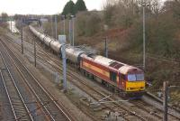 60035, still in EWS livery, joins the WCML at Farington Curve Junction on 11 December 2014 with the 6M32 loaded tar tank wagons from Lindsey Refinery to Preston Docks.<br><br>[John McIntyre&nbsp;11/12/2014]