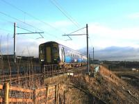 Just after crossing the Cutty Sark bridge on 12 December, 156503 passes the spot where the M8 extension will pass under the Whifflet line. The 156s will be displaced by electric trains on this route within days. <br><br>[Colin McDonald&nbsp;12/12/2014]