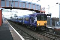 318257 coupled to 320313 arriving at Mount Vernon from Motherwell on Sunday 14th December 2014, the first day of the new electric services on the Whifflet line.<br><br>[Colin McDonald&nbsp;14/12/2014]