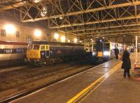 A busy scene at Carlisle station on the afternoon of 15 December 2014. A train for Manchester Airport is at platform 4, a northbound Pendolino at platform 1 and 47815 Great Western on the centre road. <br><br>[Bruce McCartney&nbsp;15/12/2014]