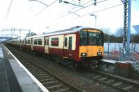 Class 318 EMUs 255 and 256 form the 1514 service to Motherwell at Mount Vernon on the 14th December 2014, the first day of the new timetable using electric rather than diesel multiple units.<br><br>[Colin McDonald&nbsp;14/12/2014]