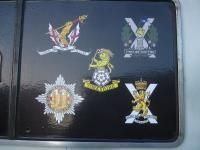 Various regimental crests adorning East Coast Railways 91111 <I>'For The Fallen'</I>, photographed at Newcastle Central on 3 December 2014.<br><br>[David Pesterfield&nbsp;03/12/2014]