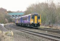 A 156/142 combination, forming a Northern service to Southport, are signalled for the Westhoughton and Wigan line at Lostock Junction. The large steel bridge in the background carries the A58 Bolton ring road over the line from Bolton. <br><br>[Mark Bartlett&nbsp;02/12/2014]