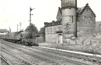 V3 2-6-2T 67646 is about to pass the <i>'Yoker Castle'</i> sewage facility shortly after leaving Yoker station in September 1958 with a Helensburgh - Bridgeton train.<br><br>[G H Robin collection by courtesy of the Mitchell Library, Glasgow&nbsp;04/09/1958]