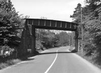 This undistinguished plate girder bridge shows the crossing of the A7 road by the Selkirk branch near the entrance to Bridgeheugh Farm. The undated photograph has been taken looking north towards Galashiels.<br><br>[Bill Jamieson Collection&nbsp;//]