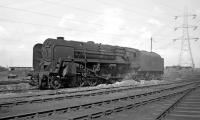 The ashpan of 9F 92063 looks as if it has just been emptied following its return to Tyne Dock shed on completion of the Saturday morning shift on 3 September 1966. Just eleven weeks after this picture was taken, 92063 (but in much better external condition) had the honour of heading the last steam hauled iron ore train to Consett.<br><br>[Bill Jamieson&nbsp;03/09/1966]